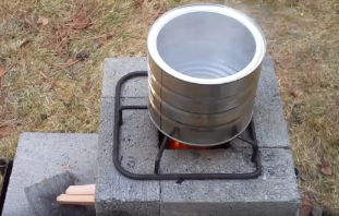 Video building an improved brick rocket stove version for How to make a rocket stove with bricks