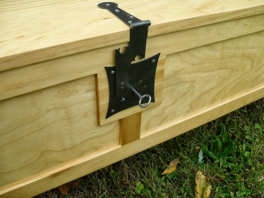 A nice wooden chest that actually unfolds into a bed in a box.