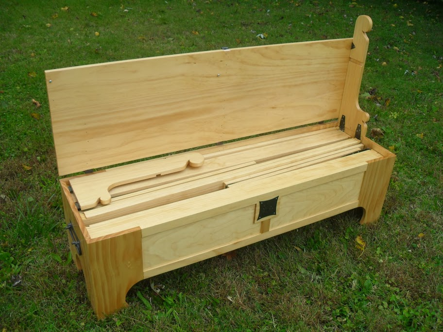 A nice wooden chest that actually unfolds into a bed.
